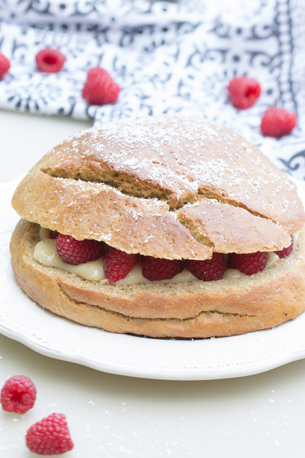 Tropezienne style brioche cake with cream and raspberries